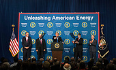 United States President Donald J. Trump (L) delivers remarks at the Unleashing American Energy event at the Department of Energy in Washington, D.C. on June 29, 2017. Trump announced a number on initiatives including his Administration's plan on rolling back regulations on energy production and development. Trump was joined by, from left to right Interior Secretary Ryan Zinke, Vice President Mike Pence, Energy Secretary Rick Perry and EPA Administrator Scott Pruitt. <br /> Credit: Kevin Dietsch / Pool via CNP