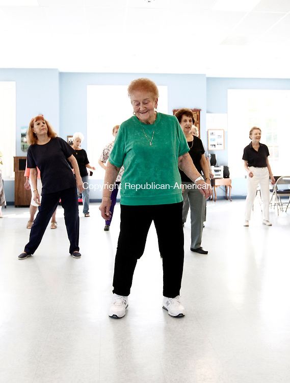 Wolcott, CT- 22 September 2014-092214CM02-  Lois Marticello, of Prospect, leads a group of women in line dancing during a dance class at the Rietdyke Senior Center in Wolcott on Monday.  Marticello, who is 88 years old, leads classes in Wolcott and in Prospect during the week.  She is assisted by  fellow dance instructor, Roberta Felesina.  For more information and to sign up for a class, please call Marticello at 203-233-1354.    Christopher Massa Republican-American