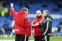 Swansea City Head Coach Francesco Guidolin chats with his coaches pictured during the pre match warm up ahead of the   Barclays Premier League match between Everton and Swansea City played at Goodison Park, Liverpool