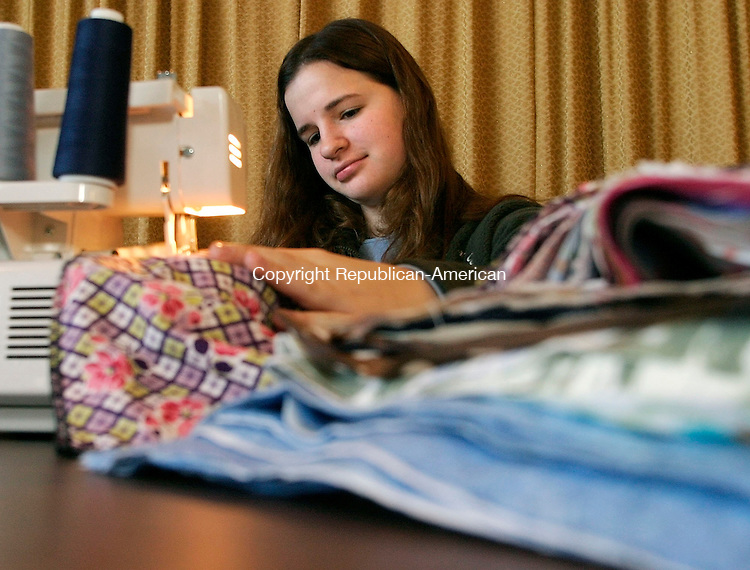 HARWINTON, CT - 26 FEBRUARY 2004 - 022605JS07--Jenn Beyus, 17, of Harwinton Emond sews some of the kerchiefs for cancer patients Saturday at the Immaculate Heart of Mary Church in Harwinton. The group is part of the Cheshire-based CUREChief program.  --Jim Shannon Photo --Immaculate Heart of Mary Church; Harwinton; Joe Emond, CUREChief are CQ