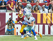 Dallas Cowboys wide receiver Cole Beasley (11) tries to elude Washington Redskins cornerback Josh Norman (24) in fourth quarter action during the game at FedEx Field in Landover, Maryland on Sunday, September 18, 2016.  Dallas Cowboys wide receiver Dez Bryant (88) look on from behind.  The Cowboys won the game 27 - 23.<br /> Credit: Ron Sachs / CNP