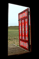 Colorfully painted door of a 'ger' or 'yurt', traditional Mongolian tent-like dwelling.  Ger doors are usually nicely decorated, as little other embellishments make up the usual ger