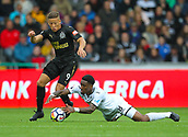 10th September 2017, Liberty Stadium, Swansea, Wales; EPL Premier League football, Swansea versus Newcastle United; Dwight Gayle of Newcastle United and Leroy Fer of Swansea City challenge for the ball during the match