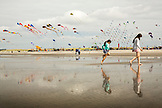USA, Washington State, Long Beach Peninsula, International Kite Festival, sisters enjoy the beach at the kite festival