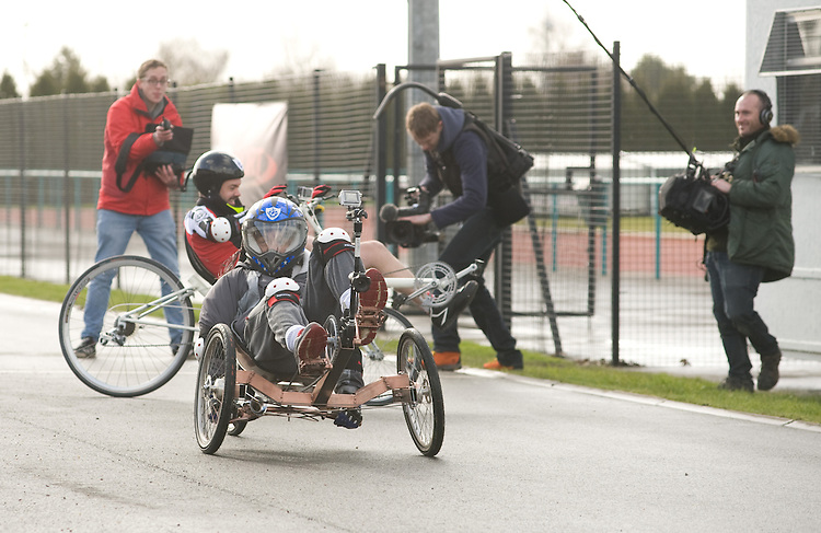 Blue Peter presenters have gone head-to-head on their personally modified bikes in a cycle race for Sport Relief 2014.  Pictured is Radzi Chinyanganya (front) and Barney Harwood during the race<br /> <br /> Photo by Chris Vaughan/CameraSport<br /> <br /> Commercial - Sport Relief -  publicity shoot - Tuesday 4th March 2014 - University of Central Lancashire Sports Arena - Preston<br /> <br /> &copy; CameraSport - 43 Linden Ave. Countesthorpe. Leicester. England. LE8 5PG - Tel: +44 (0) 116 277 4147 - admin@camerasport.com - www.camerasport.com