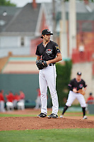 Erie SeaWolves relief pitcher Adam Ravenelle (12) gets ready to deliver a pitch during a game against the New Hampshire Fisher Cats on June 20, 2018 at UPMC Park in Erie, Pennsylvania.  New Hampshire defeated Erie 10-9.  (Mike Janes/Four Seam Images)