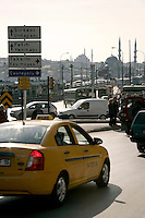 Traffic at Karakoy, Istanbul, Turkey. The Beyazid and New Mosques are in the distance