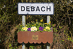 Village sign with pretty box of growing flowers beneath it, Debach, Suffolk, England