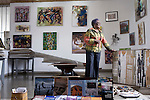 ACCRA, GHANA - JUNE 13: Frances Ademoa, an art gallery owner, stands in her showroom with local art on June 13, 2008 in central Accra, Ghana. Mrs. Ademoa hopes to increase her domestic and export business by working with Herman Chinery-Hesse, a local software entrepreneur, who is pioneering to bringing e-commerce to remote corners of the continent. (Photo by Per-Anders Pettersson)....