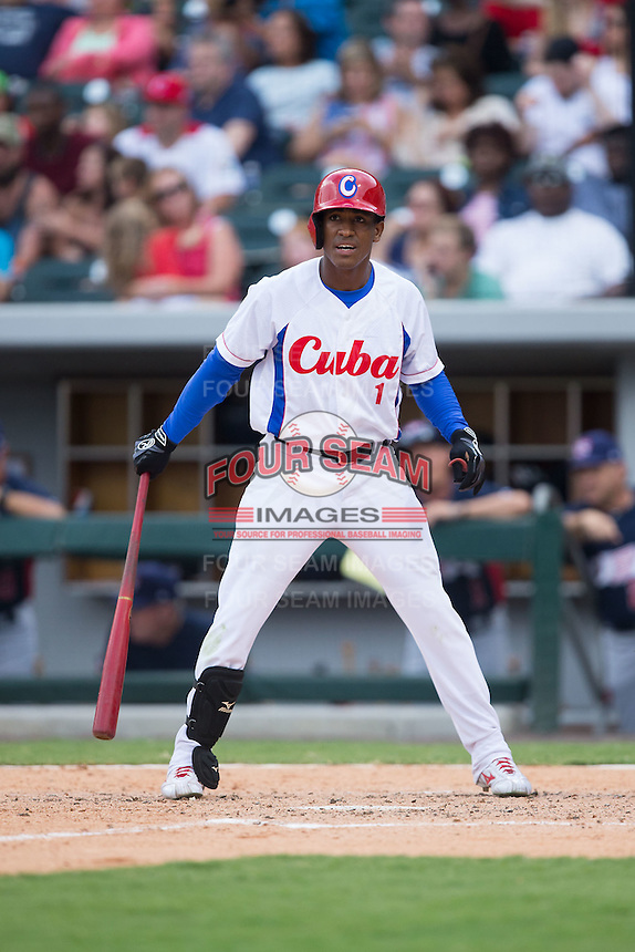 Roel Santos Martinez (1) of the Cuban National Team at bat against the US Collegiate National Team at BB&T BallPark on July 4, 2015 in Charlotte, North Carolina.  The United State Collegiate National Team defeated the Cuban National Team 11-1.  (Brian Westerholt/Four Seam Images)