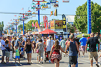 A large crowd walks on the midway at the Ohio State Fair in Columbus, Ohio.