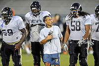 12 August 2011:  FIU Assistant Coach Alex Mirabal speaks with Prince Matt (58) (also pictured, Donald Senat (59), David Delsoin (50)) during a scrimmage held as part of the FIU 2011 Panther Preview at University Park Stadium in Miami, Florida.