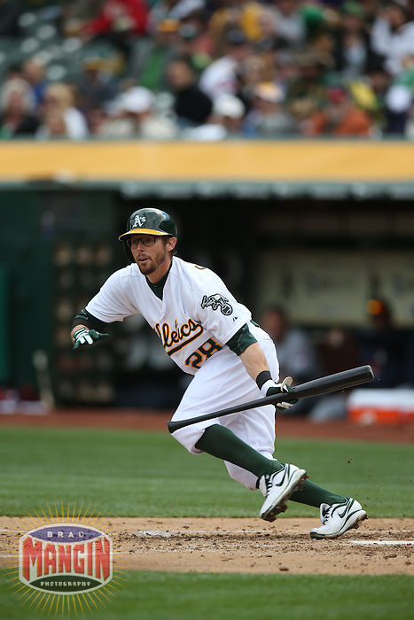 OAKLAND, CA - APRIL 2:  Eric Sogard #28 of the Oakland Athletics bunts against the Cleveland Indians during the game at O.co Coliseum on Wednesday, April 2, 2014 in Oakland, California. Photo by Brad Mangin