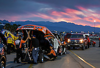 Apr. 5, 2013; Las Vegas, NV, USA: NHRA funny car driver Johnny Gray and crew members in the staging lanes at sunset during qualifying for the Summitracing.com Nationals at the Strip at Las Vegas Motor Speedway. Mandatory Credit: Mark J. Rebilas-