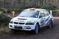 Dougal Brown - Lewis Rochford in a Mitsubishi Evolution 9 competing at Junction 6 on the Munro Scotch Beef Millbuie Special Stage 1 on the 2014 Arnold Clark/Thistle Hotel Snowman Rally, supported by Highland Office Equipment, part of Capital Document Solutions which was organised by Highland Car Club and based in Inverness on 22.2.14; Round 1 of the 2014 RAC MSA Scottish Rally Championship sponsored by ARR Craib Transport Limited.