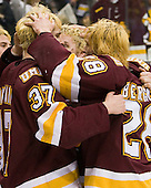 Justin Fontaine (Duluth - 37), Mike Connolly (Duluth - 22), Wade Bergman (Duluth - 28) - The University of Minnesota-Duluth Bulldogs celebrated their 2011 D1 National Championship win on Saturday, April 9, 2011, at the Xcel Energy Center in St. Paul, Minnesota.
