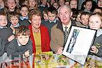 HAPPY DAYS: Richard Tuohy from Beaufort who retired  as Caretaker of Cullina National School on Friday last..He is pictured with school principle Nora Mai Kelliher and pupils at the school who made a presentation to Richard.   Copyright Kerry's Eye 2008