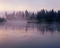 67ORCAC_025 - USA, Oregon, Deschutes National Forest, Fog hovers above the Deschutes River at dawn.