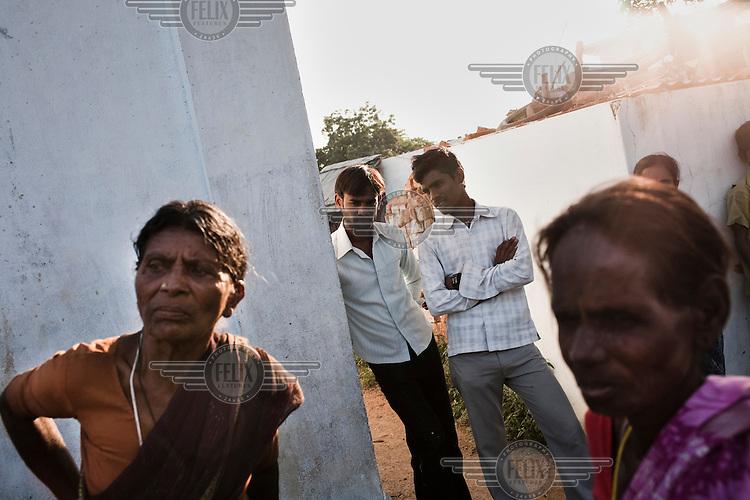 Spectators at a microfinance group meeting in Boilakunta village near Mahabubnagar.