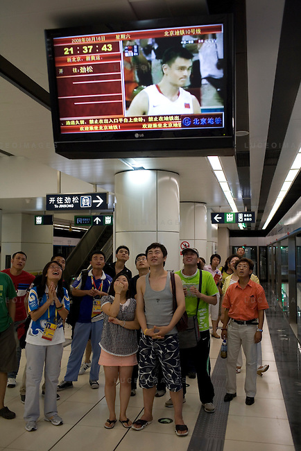Locals watch the China vs Germany basketball game in the subway station in Beijing, China on Saturday, August 16, 2008.  Kevin German