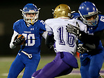 SIOUX FALLS, SD - OCTOBER 25: Parker Nelson #20 from Sioux Falls Christian looks for running room past Joren Bruun #16 from Winner in the first half of their 11B playoff game Thursday nigh at Bob Young Field in Sioux Falls.(Photo by Dave Eggen/Inertia)