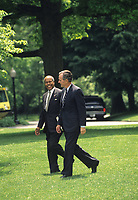 Washington DC., USA,  1989<br /> President  H.W. Bush walks across the South Lawn of the White House with Health and Human Services Secretary Louis Sullivan. Credit: Mark Reinstein/MediaPunch