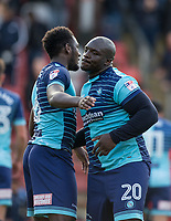 Adebayo Akinfenwa of Wycombe Wanderers with Aaron Pierre of Wycombe Wanderers after the Sky Bet League 2 match between Leyton Orient and Wycombe Wanderers at the Matchroom Stadium, London, England on 1 April 2017. Photo by Andy Rowland.