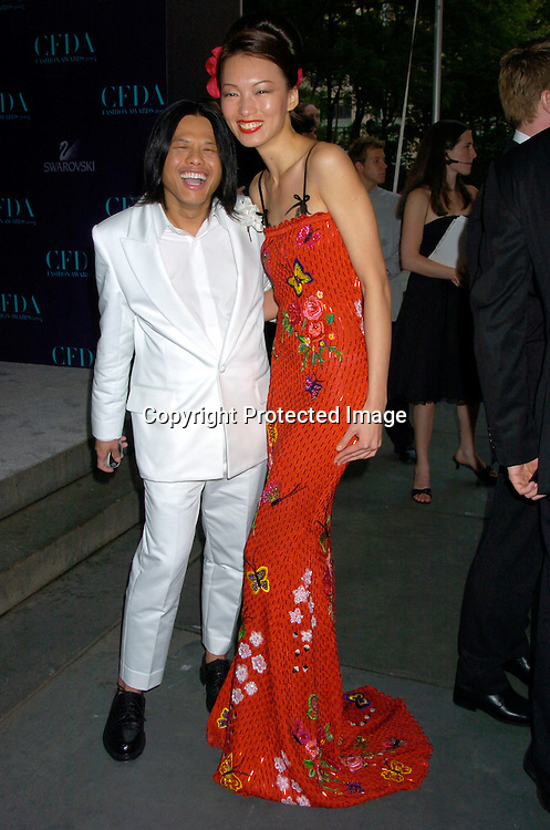 Zang toi and model ..at the  2004 CFDA Fashion Awards on June 7, 2004 at ..The New York Public Library.                                           Photo by Robin Platzer, Twin Images