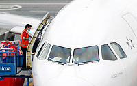 RIONEGRO, COLOMBIA - MAY 12: An operator with Avianca airline wears a facial mask on the runway of José María Córdoba International Airport on May 12, 2020 in Rionegro. Avianca filed for bankruptcy in the United States on May 11, 2020 to reorganize its debt due to the impact of the coronavirus pandemic. (Photo by Fredy Builes / VIEWpress via Getty Images)