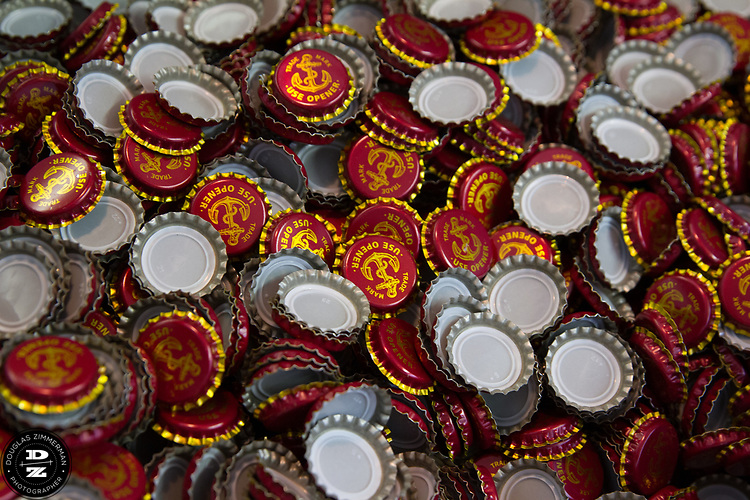 Keith Greggor, president and CEO of Anchor Brewers & Distillers at the Anchor Steam brewery in San Francisco, Calif.  Bottle caps for the Anchor Beer line.