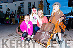 Serena Corkery waiting for the train with her mum Olivia and siblings Sian and Edie at the unveiling of the statue in Killorglin Saturday night