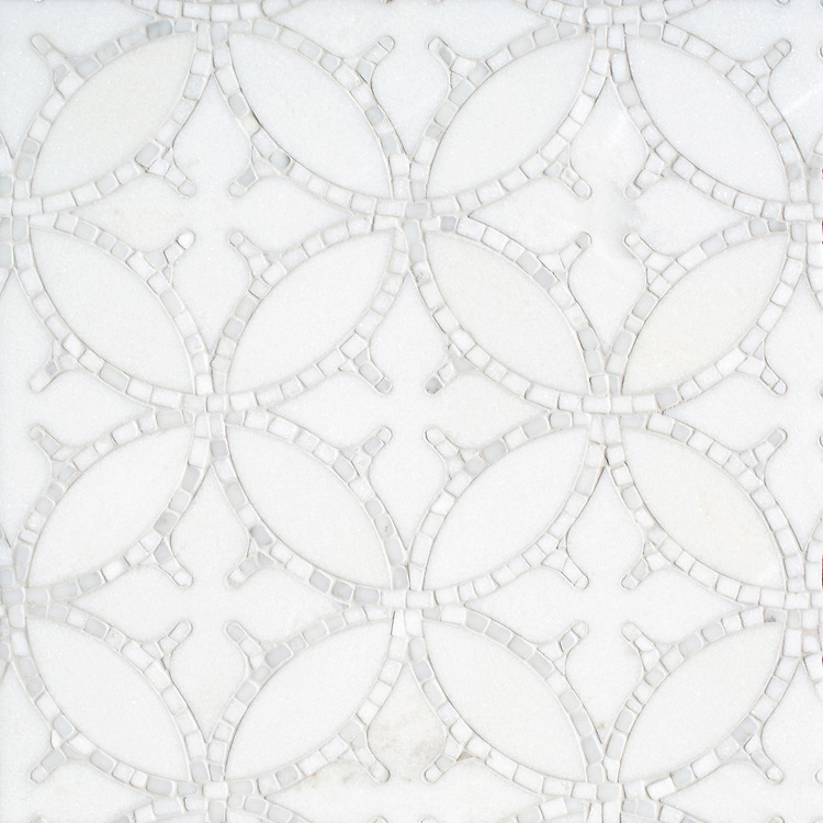 Omar, a hand-cut and waterjet stone mosaic, shown in polished Thassos and hand-chopped tumbled Calacatta, is part of the Legend® Collection by New Ravenna.