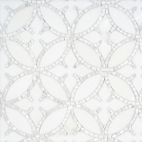 Omar, a hand-cut and waterjet stone mosaic, shown in polished Thassos and hand-chopped tumbled Calacatta, is part of the Legend™ collection by New Ravenna.