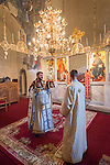 Church of the Ascension of Jesus Christ at the Monastery Mileševa, Serbia originally built in the 13th century. Reverend Hieromonk Leontije, monastery priest, speaks with a reader.