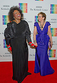 Jessye Norman, left, and Adrienne Arsht, right, share a laugh as they arrive for the formal Artist's Dinner honoring the recipients of the 2013 Kennedy Center Honors hosted by United States Secretary of State John F. Kerry at the U.S. Department of State in Washington, D.C. on Saturday, December 7, 2013. The 2013 honorees are: opera singer Martina Arroyo; pianist,  keyboardist, bandleader and composer Herbie Hancock; pianist, singer and songwriter Billy Joel; actress Shirley MacLaine; and musician and songwriter Carlos Santana.<br /> Credit: Ron Sachs / CNP