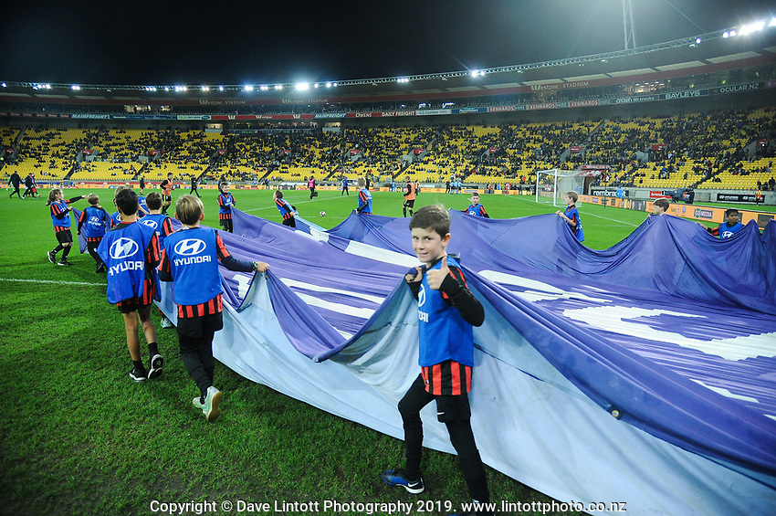 Kids take a banner out for halftime during the A-League football match between Wellington Phoenix and Melbourne City FC at Westpac Stadium in Wellington, New Zealand on Sunday, 21 April 2019. Photo: Dave Lintott / lintottphoto.co.nz