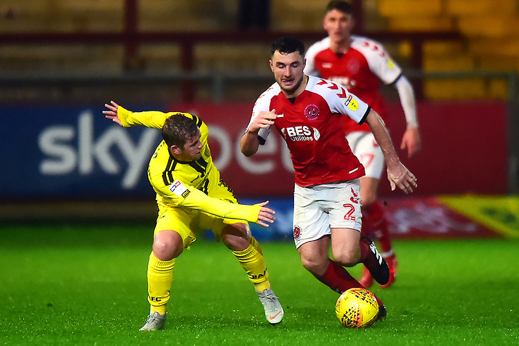 Fleetwood Town's Lewis Coyle competes with Burton Albion's Lucas Akins<br /> <br /> Photographer Richard Martin-Roberts/CameraSport<br /> <br /> The EFL Sky Bet League One - Saturday 15th December 2018 - Fleetwood Town v Burton Albion - Highbury Stadium - Fleetwood<br /> <br /> World Copyright © 2018 CameraSport. All rights reserved. 43 Linden Ave. Countesthorpe. Leicester. England. LE8 5PG - Tel: +44 (0) 116 277 4147 - admin@camerasport.com - www.camerasport.com