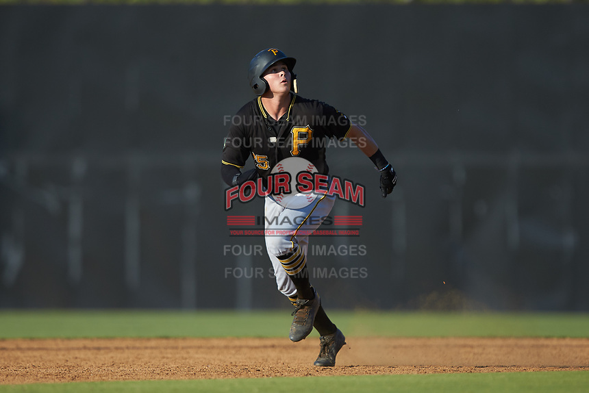 Conner Uselton (25) of the Bristol Pirates watches the ball as he takes off for third base against the Danville Braves at American Legion Post 325 Field on July 1, 2018 in Danville, Virginia. The Braves defeated the Pirates 3-2 in 10 innings. (Brian Westerholt/Four Seam Images)