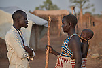 Ganun Butros Wadko (left) talks with a woman in the Doro Refugee Camp in Maban County, South Sudan. Doro is one of four camps in Maban which together shelter more than 130,000 refugees from the Blue Nile region of Sudan. Jesuit Refugee Service, with support from Misean Cara, provides educational and psychosocial services to both refugees and the host community. Wadko, a refugee himself, is supervisor of the JRS psychosocial team's home visits in the Doro Camp.