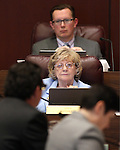 Nevada Sens. Joyce Woodhouse, D-Henderson, and Ben Kieckhefer, R-Reno, work in committee at the Legislative Building in Carson City, Nev., on Thursday, March 19, 2015. <br /> Photo by Cathleen Allison