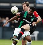 Nederland, Rotterdam, 23 december  2012.Eredivisie.Seizoen 2012/2013.Feyenoord-FC Groningen.Genero Zeefuik van FC Groningen in duel om de bal met Joris Mathijsen van Feyenoord