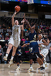 Alex Sharp (14) of the Wake Forest Demon Deacons drives to the basket past Anne Francoise Diouf (4) of the Georgia Tech Yellow Jackets during first half action at the LJVM Coliseum on January 22, 2017 in Winston-Salem, North Carolina.  The Demon Deacons defeated the Yellow Jackets 70-65 in overtime.  (Brian Westerholt/Sports On Film)