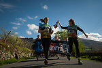 "Two women carry the baton as they run on the 20th Korrika. Erratzu (Basque Country) April 3, 2017. The ""Korrika"" is a relay course, with a wooden baton that passes from hand to hand without interruption, organised every two years in a bid to promote the basque language. The Korrika runs over 11 days and 10 nights, crossing many Basque villages and cities, totalling some 2300 kilometres. Some people consider it an honour to carry the baton with the symbol of the Basques, ""buying"" kilometres to support Basque language teaching. (Gari Garaialde / Bostok Photo)"