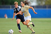 27 August 2011:  FIU's Marie Egan (13) moves the ball upfield while being pursued by Akron's Ashley Hughes (7) in the first half as the FIU Golden Panthers defeated the University of Arkon Zips, 1-0, at University Park Stadium in Miami, Florida.