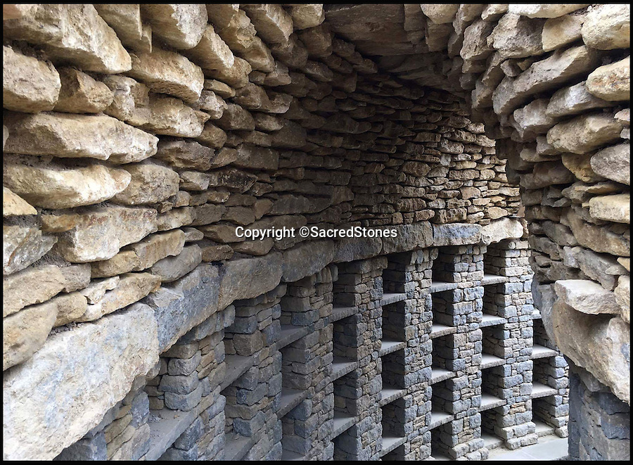 BNPS.co.uk (01202 558833)<br /> Pic: SacredStones/BNPS<br /> <br /> The earth covered barrow contains 400 niches for families to reserve at £2000 to £5000 a plot.<br /> <br /> Building boom after 4000 years - Neolithic barrows are being built again as burial mounds for modern Britons.<br /> <br /> Prehistoric tombs used to store the ashes of loved ones are being built on UK soil for the first time in thousands of years. <br /> <br /> Until now Neolithic earth mounds built over the dead, known as long barrows, had not been used since around 2,000 BC. <br /> <br /> The limestone frame covered in soil and grass was entirely handmade by a team of four stonemasons using traditional techniques over the course of five months. <br /> <br /> The firm will be selling 400 plots, or niches, near St Neots, Cambs, for between £1,950 and £7000.