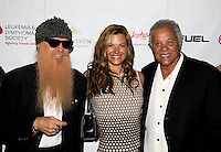 Aug. 29, 2013; Avon, IN, USA: ZZ Top guitarist/vocalist Billy Gibbons (left), wife Gilligan Stillwater (center) and NHRA drag racer Don Prudhomme on the red carpetprior to the premiere of Snake & Mongoo$e at the Regal Shiloh Crossing Stadium 18. Mandatory Credit: Mark J. Rebilas-