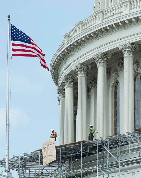 UNITED STATES - JUNE 25: Workers begin removing scaffolding around the base of the Capitol dome on Monday, June 25, 2012. Restoration of the Capitol Dome skirt has been underway since last fall, and is scheduled to be completed by the fall of this year in time for the 2013 Inauguration. (Photo By Bill Clark/CQ Roll Call)