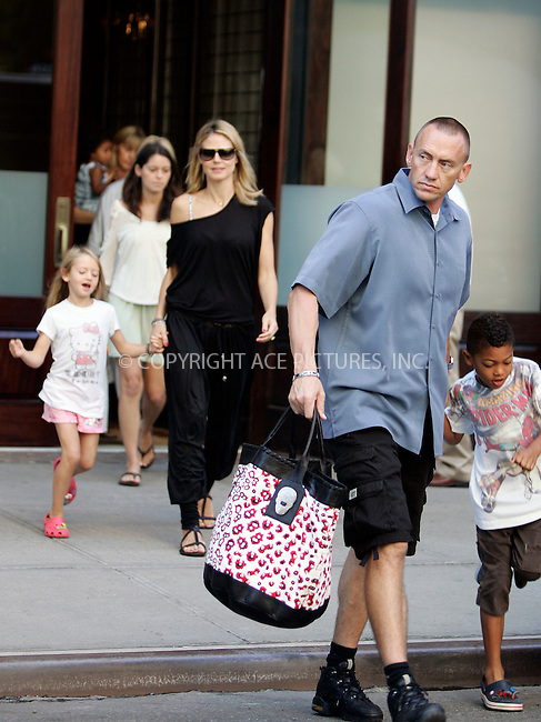 WWW.ACEPIXS.COM . . . . .  ....July 1 2011, New York City....TV personality Heidi Klum and the family bodyguard packs her family into a minibus and sets off out of the City for the holiday weekend on July 1 2011in New York City....Please byline: CURTIS MEANS - ACE PICTURES.... *** ***..Ace Pictures, Inc:  ..Philip Vaughan (212) 243-8787 or (646) 679 0430..e-mail: info@acepixs.com..web: http://www.acepixs.com
