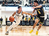 WASHINGTON, DC - FEBRUARY 22: Armel Potter #2 of George Washington pushes his way past Scott Spencer #2 of La Salle during a game between La Salle and George Washington at Charles E Smith Center on February 22, 2020 in Washington, DC.
