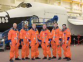 Attired in training versions of their shuttle launch and entry suits, the STS-133 crew members take a brief break for a portrait in the Space Vehicle Mock-up Facility at the National Aeronautics and Space Administration's (NASA) Johnson Space Center on March 31, 2010. From the left are NASA astronauts Tim Kopra and Alvin Drew, both mission specialists; Eric Boe, pilot; Steve Lindsey, commander; Michael Barratt and Nicole Stott, both mission specialists.  STS-133, aboard the Space Shuttle Discovery, is scheduled for launch Monday, November 1, 2010 at 4:40 p.m. EDT..Mandatory Credit: James Blair / NASA via CNP